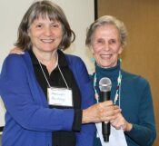 [Outgoing LWVNM President Judy Williams welcomes new Presiden Hannah Burling]